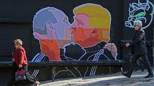 A street mural in Vilnius, Lithuania shows Vladimir Putin and the 45th president of the United States . . . best friends.